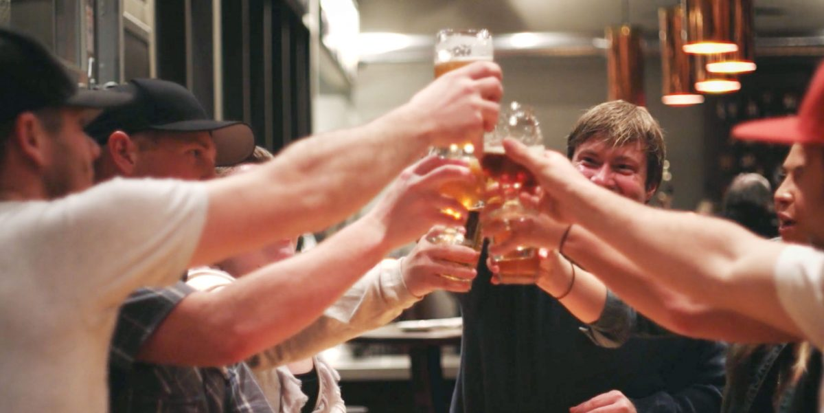 Destination Beer case study photo, people cheers-ing with beers